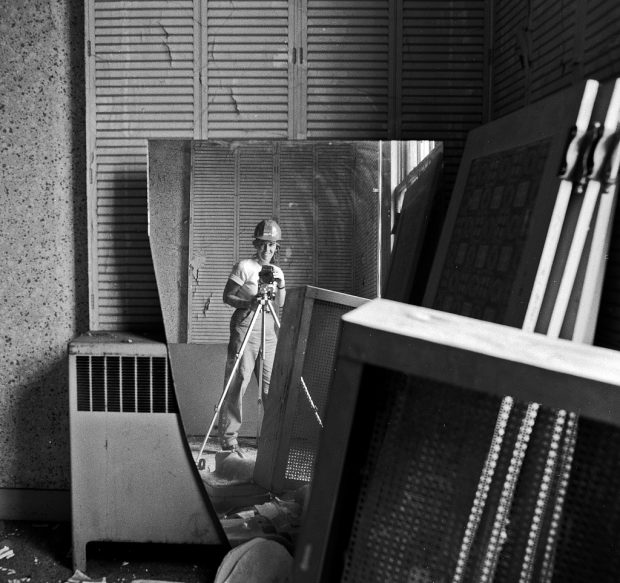 Self portrait of photographer Carol M. Highsmith, via a broken mirror that she photographed during the Willard Hotel restoration. Washington, D.C.