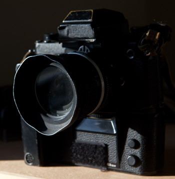 Camera? Used - $350. Motor? Used - $150. Wide angle lens? Used - $225. Filter and hood were probably new.